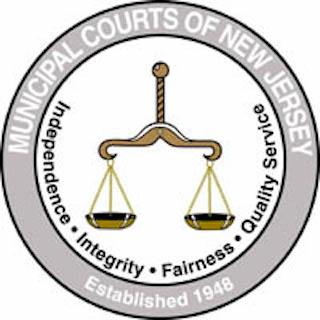 Municipal Court logo of a weighted scale surrounded by a circle